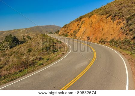 Road With An Curve Through Hills