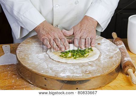 Rolling chopped scallions