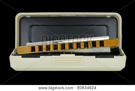 Blues Harp & Case Isolated On Black Background