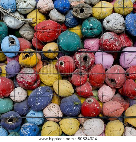 Colorful Waste Of Coconut Husks In Grate Background Texture.
