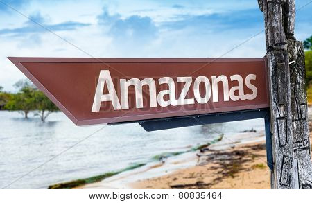 Amazonas wooden sign with a lake background