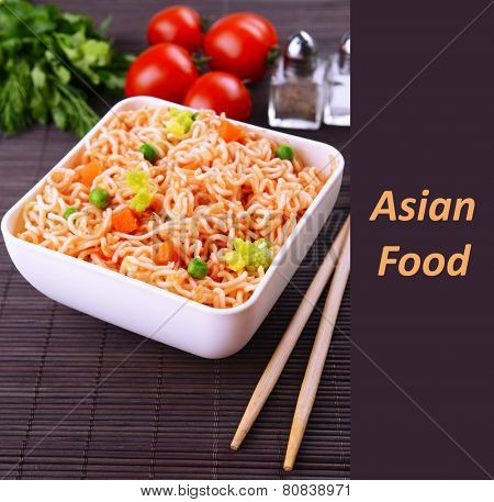 Asian food, noodles in bowl with vegetables and space for your text