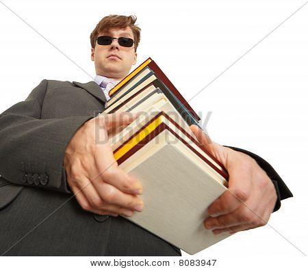 Man In Dark Glasses Holding A Books