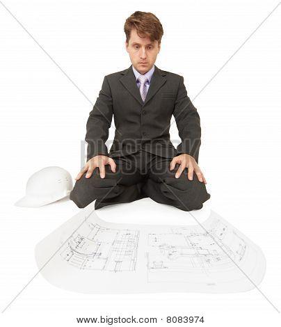 Serious Engineer Ponders Bent Over Drawings