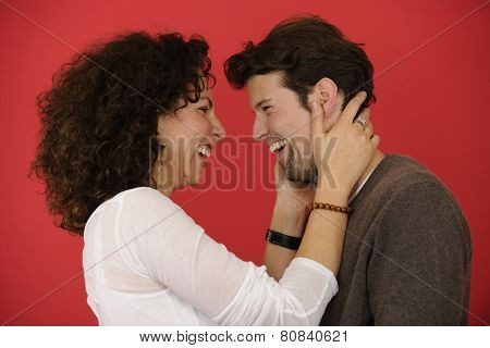 portrait of an happy couple on red background
