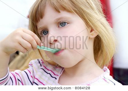 Blond Little Girl Eating Ice Cream Portrait