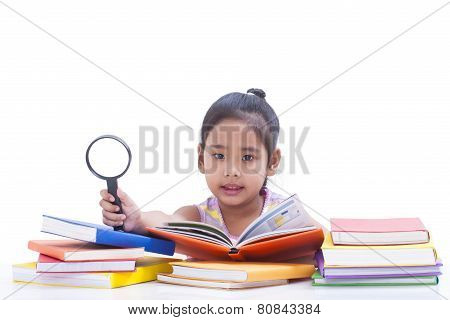 Little girl is reading book.