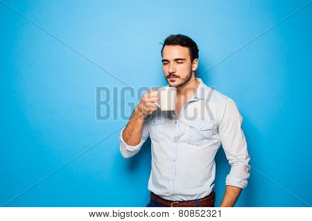 Handsome Adult Man Wearing Casual Clothes On  Blue Background