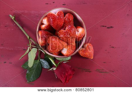 Happy Valentines Day Bowl Of Luscious Heart Shape Red Strawberries On A Red Vintage Wood Background,