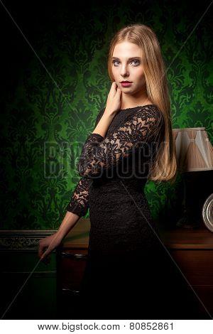 Sexy Woman In Black Dress In Green Retro Interior