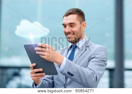 cloud computing, business, internet technology and people concept - smiling businessmanwith tablet pc computer on city street