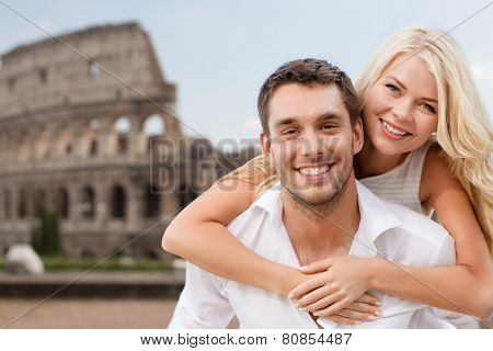 summer holidays, travel, tourism, people and dating concept - happy couple hugging over coliseum background