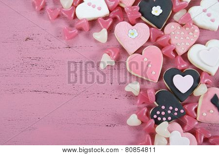 Romantic Heart Shape Pink, White And Black Cookies And Candy Background On Vintage Shabby Chic Pink
