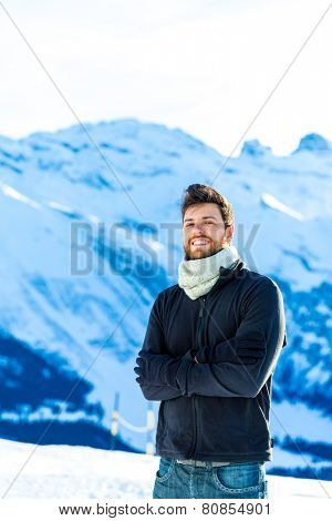 Handsome guy smiling in the Alps.