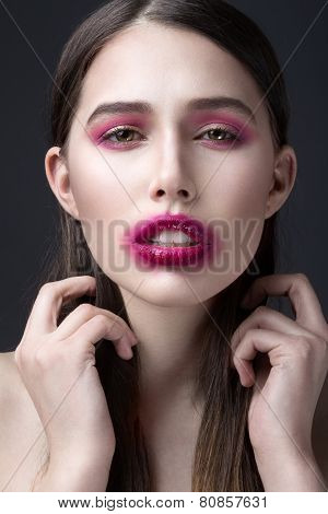 Girl with pink lipstick smeared across his face. Creative makeup.