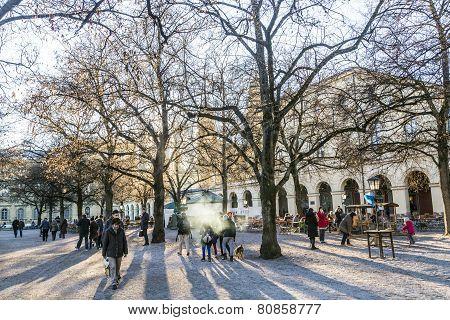 People Enjoy The Chinook Wind In The Hofgarten