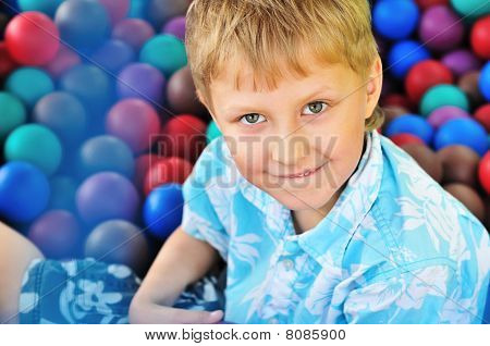 Boy In Pile Of Balls