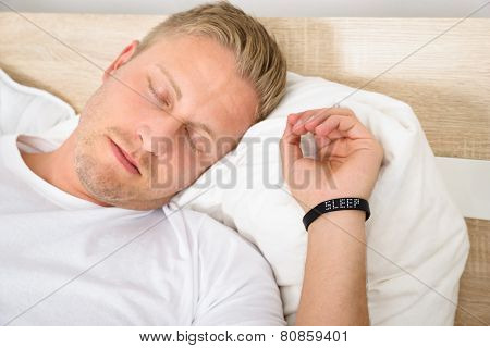 Man Wearing Smart Wristband While Sleeping