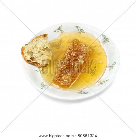 Plate With Honey And Honeycomb. Isolated.