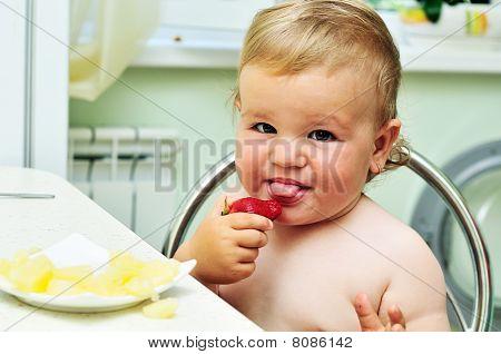 Little  Girl Tasting Strawberry