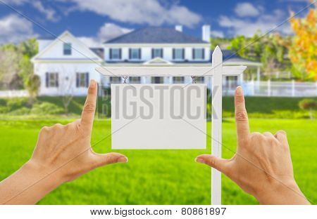 Female Hands Framing Home Blank Real Estate Sign in Front of New House.