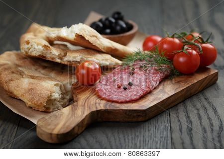 Antipasti With Salami, Olives, Tomatoes And Bread