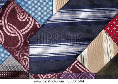 Many Ties Of Various Colors, Which Intertwined