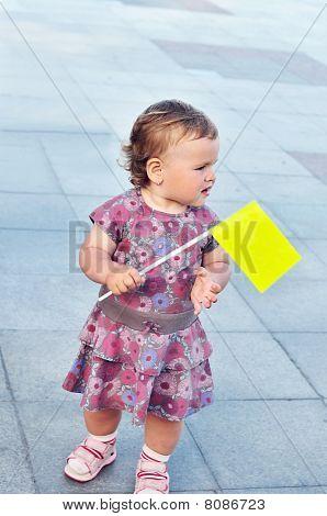 Baby Girl Holding Flag
