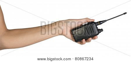 Female hand holding portable radio transmitter