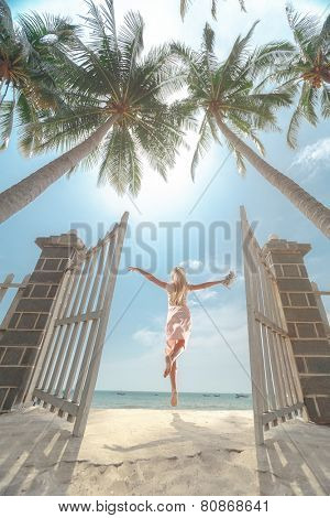 Young beautiful women jumping on the sunny tropical