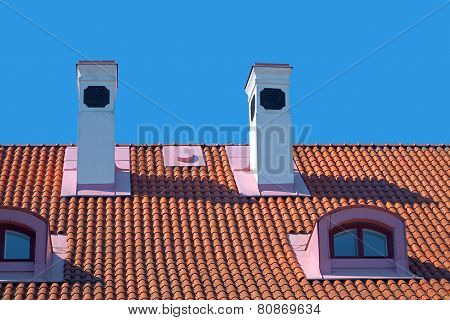 Chimneys On Red Roof.