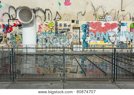 The wall filled with graffiti near Pompidou Center in Paris