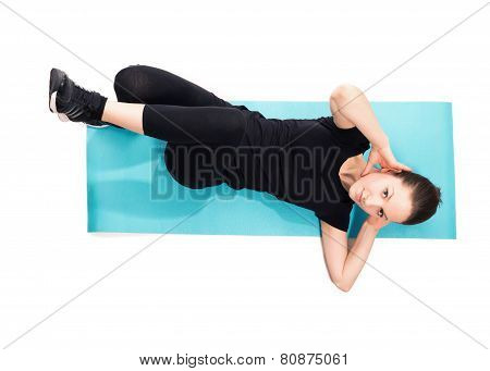 Fit woman doing crunches on exercise mat