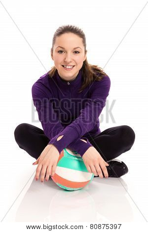 Smiling woman with volley ball