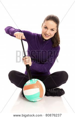 Woman pumping volley ball