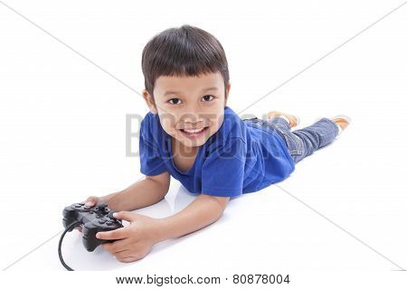 Boy playing video game and lying on the floor Boy playing video game