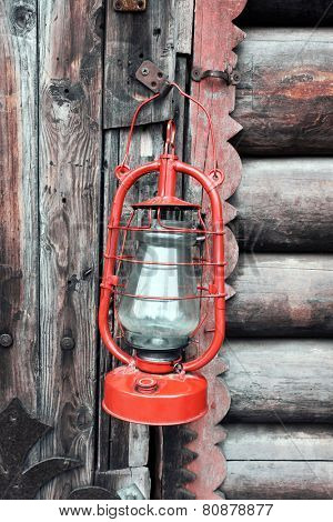 Kerosene lamp on wooden door background