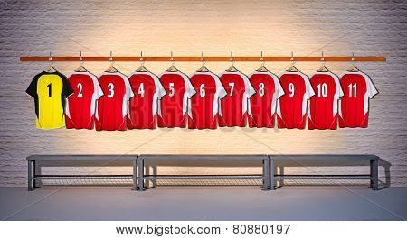 Row of Red and Yellow Football Shirts 1-11