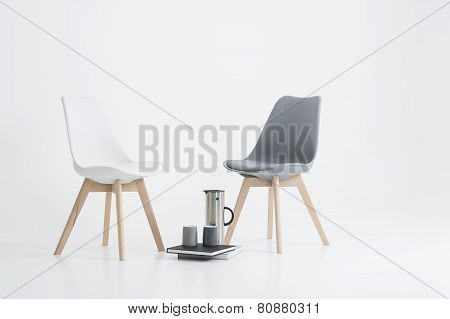 Two Modern Chairs With A Serving Of Coffee