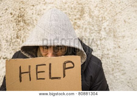 Young Guy With Cardboard Sign Seeking Help