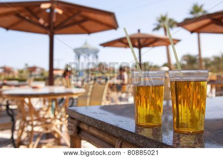 Two glasses of beer on the table corner in the summer heat in Egypt