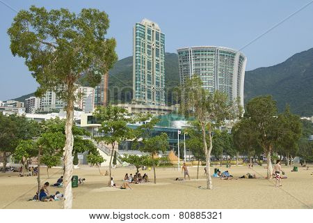 People sunbathe at the Stanley town beach, Hong Kong, China.