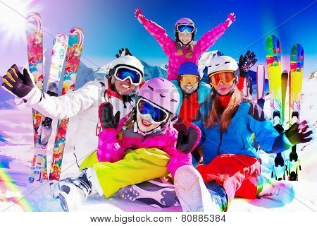 Skiing, winter, snow, skiers, sun and fun - family enjoying winter vacations, filtered