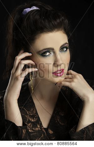 Portrait of beautiful eighties woman with colorful makeup