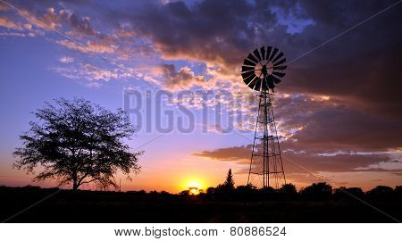 Windmill In Desert Sunset