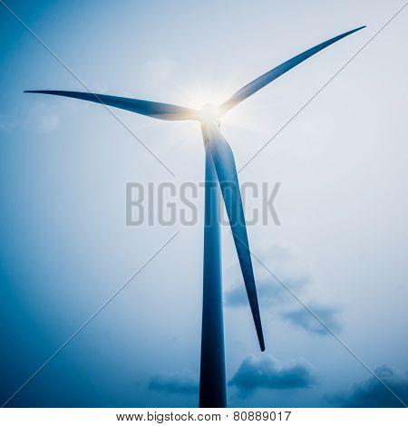 wind generators against,the blue sky, blue toned.