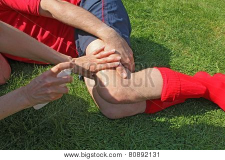 Treating injured sportsman on playing field