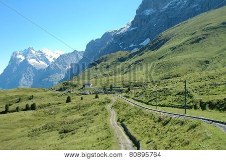 Peaks And Railway Tracks Nearby Grindelwald In Switzerland