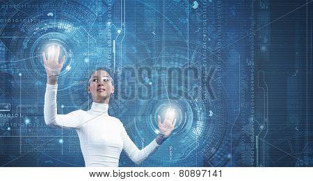 Young pretty asian woman touching digital hologram