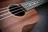 stock photo of ukulele  - Close up of ukulele selective focus with vignette - JPG